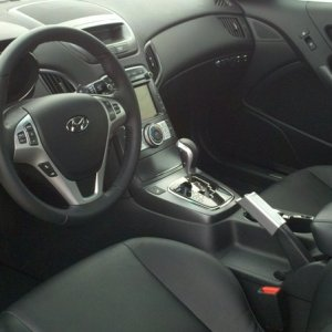 Updated interior pic with Silver OEM steering wheel trim with black buttons and silver OEM climate control